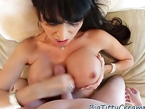 Busty MILF titfucking in pov with fake boobs