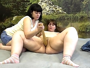 Girl pokes a baseball bat in her friend'_s pussy