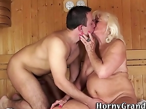 Fat granny blows in sauna
