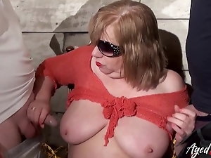 Broad in the beam mature whore enjoys blowing two dominating dicks