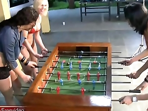 T-girls strip down underclothes and nylons playing foosball